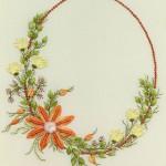 daire şeklinde çiçekli ve mineli brezilya nakışı