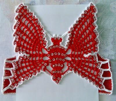 kırmızı beyaz kelebek desenli şirin kız bebek süveteri örneği