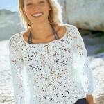 beyaz uzun kollu motiflerle örülen bluz modeli