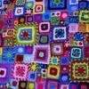rengarenk motiflerle örülen şık bir örtü modeli